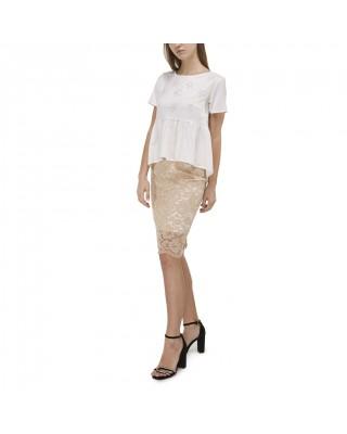 Біла блуза з воланом і вишивкою