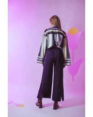 Шелковые брюки широкого кроя с декоративной подвязкой и боковыми разрезами